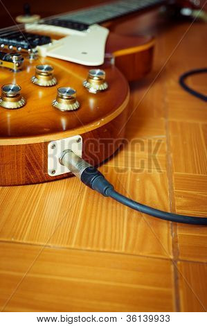 Electric Guitar On Floor With Cable