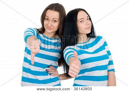 Two Attractive Girls Show Thumbs