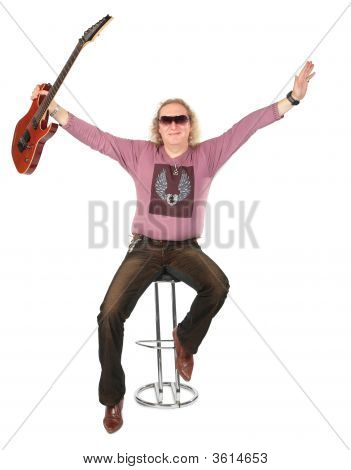 Happy Man With Guitar In Raises Hand
