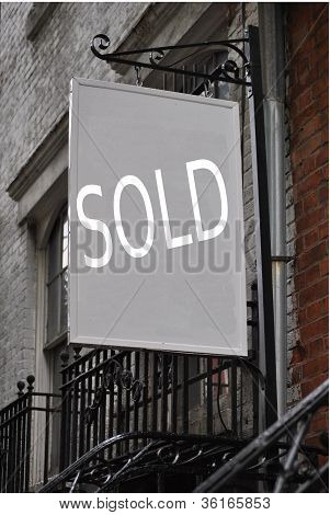 building with sold sign