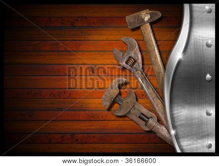 Set Of Old Tools On Wood Panel