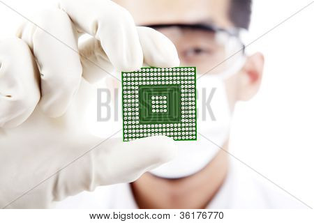 Male Scientist Shows A Microchip