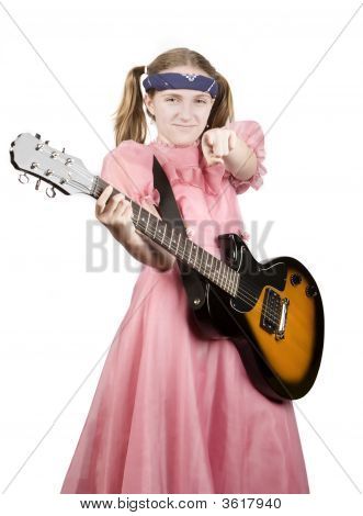 Young Girl With A Rock Guitar Pointing To The Audience