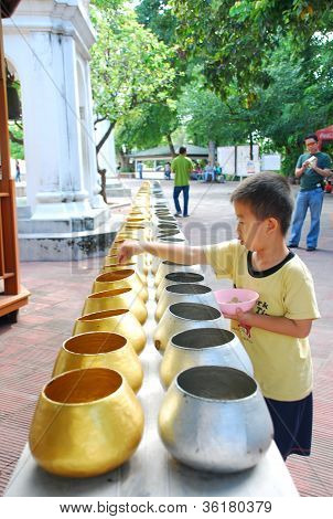 Thai boy making merit