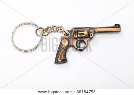 Arma de brinquedo com chaveiro