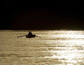 pic of nubian  - Traditional nubian fishermen on the River Nile silhouetted in the sunset - JPG