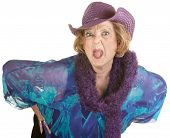 stock photo of outrageous  - Angry senior woman in hat sticking out her tongue - JPG