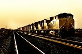 Freight Train Traveling Through Desert