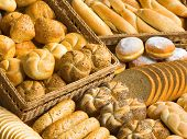 picture of bread rolls  - Assortment of fresh bread rolls buns and donuts