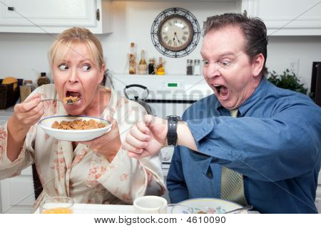 Eating Couple In Kitchen Late For Work