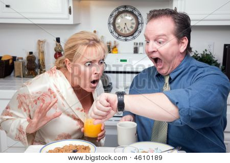 Shocked Couple In Kitchen Late For Work