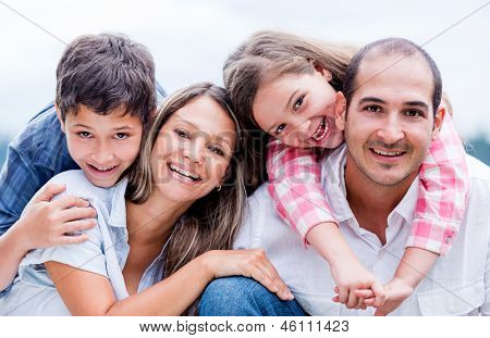 Portrait of a happy loving family smiling outdoors