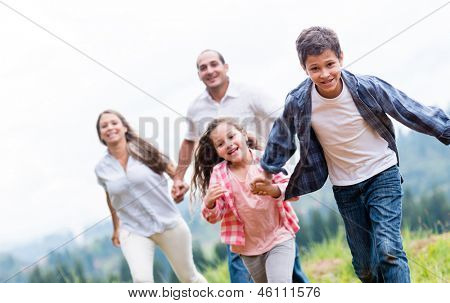 Kids having fun with their family outdoors