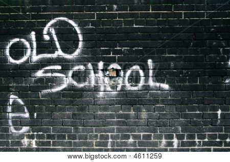 Old School Graffiti Wall With One Brick Missing.