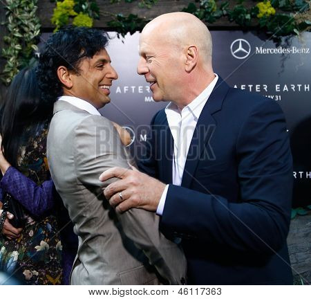 "NEW YORK - MAY 29: Actor Bruce Willis (R) and M. Night Shyamalan attend the premiere of ""After Earth"" at the Ziegfeld Theatre on May 29, 2013 in New York City."