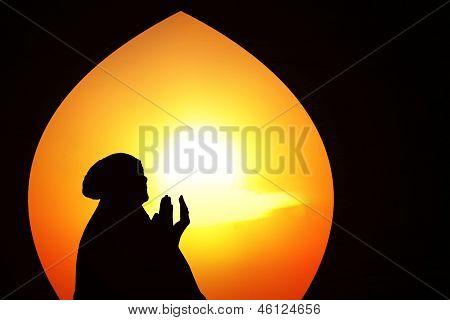 Beautiful Orange Silhouette Of Muslim Praying At Mosque