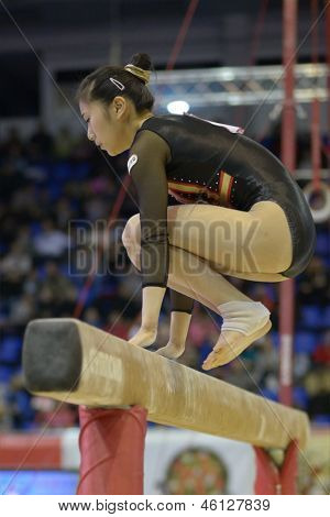 KIEV, UKRAINE - MARCH 31: Noda Sakura, Japan performs routine on balance beam during International Tournament in Artistic Gymnastics Stella Zakharova Cup in Kiev, Ukraine on March 31, 2013