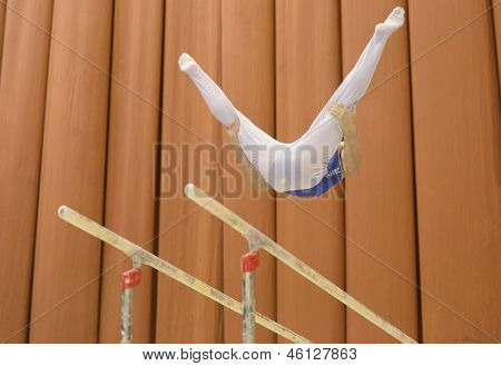 KIEV, UKRAINE - MARCH 30: Georgie Petrosiyan, Ukraine performs exercise on parallel bars during International Tournament in Artistic Gymnastics Stella Zakharova Cup in Kiev, Ukraine on March 30, 2013