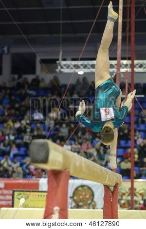 KIEV, UKRAINE - MARCH 31: Aliya Mustafina, Russia performs routine on balance beam during International Tournament in Artistic Gymnastics Stella Zakharova Cup in Kiev, Ukraine on March 31, 2013