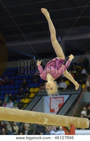 KIEV, UKRAINE - MARCH 31: Polina Fedorova, Russia performs routine on balance beam during International Tournament in Artistic Gymnastics Stella Zakharova Cup in Kiev, Ukraine on March 31, 2013