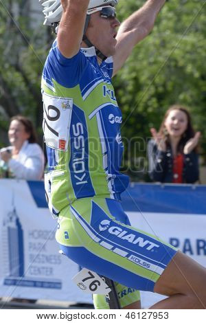KIEV, UKRAINE - MAY 24: Denis Kostyuk, Kolss cycling team, Ukraine, win the bicycle racing Race Horizon Park in Kiev, Ukraine on May 24, 2013