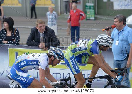 KIEV, UKRAINE - MAY 24: Alexander Sheydyk, ISD continental team, Ukraine, and Andrey Khripta, Kolss cycling team, Ukraine in the bicycle racing Race Horizon Park in Kiev, Ukraine on May 24, 2013