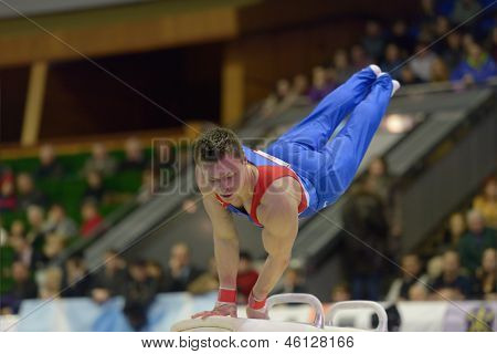 KIEV, UKRAINE - MARCH 31: Glenn Smink, Netherlands performs exercise on pommel horse during International Tournament in Artistic Gymnastics Stella Zakharova Cup in Kiev, Ukraine on March 31, 2013