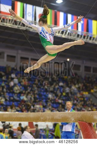 KIEV, UKRAINE - MARCH 30: Elena Rega, Uzbekistan performs balance beam exercise during International Tournament in Artistic Gymnastics Stella Zakharova Cup in Kiev, Ukraine on March 30, 2013