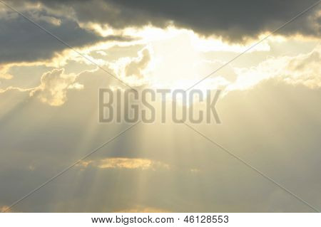 Sun's rays passing through the cloud.