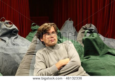 Attentive man watches movie in comfortable seat of small cinema theater.