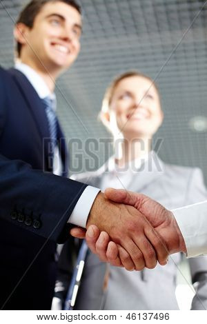 Close-up of two men hands shaking after signing contract