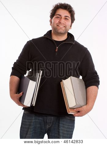 Happy young man holding books