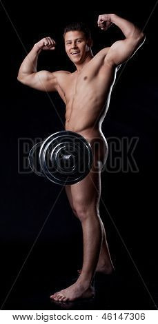 Smiling muscular nude heavyweight posing with rod