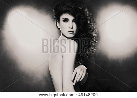 Fashion photo of sensual brunette woman with shiny curly hair