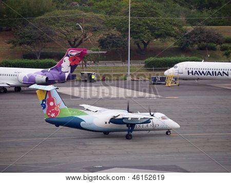 Island Air Propeller Plane Taxis On Runway