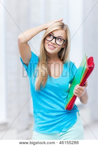 picture of stressed student with folders in campus