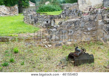 Destroyed Oradour sur Glane in the French Limousin with rusty sewing machine