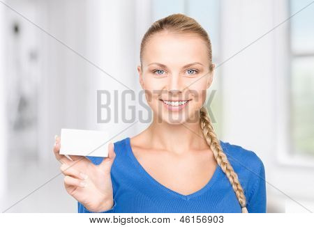 happy woman with business card in office