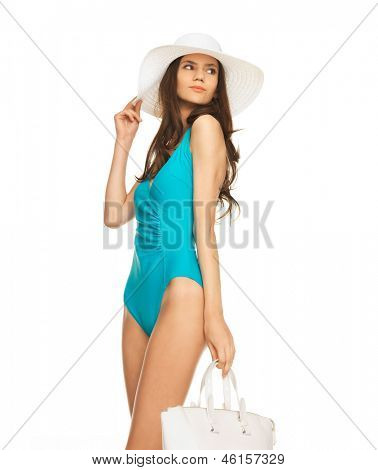 picture of model posing in swimsuit with hat and handbag.