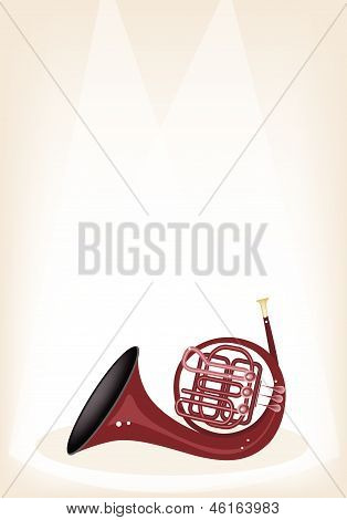 A Musical French Horn On Brown Stage Background