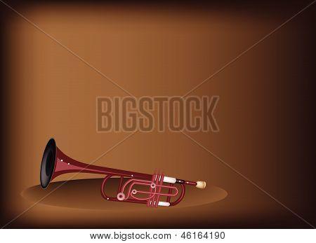 A Musical Trumpet On Dark Brown Background