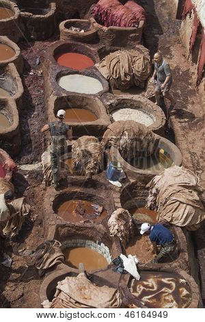 Men At Work In Tannery