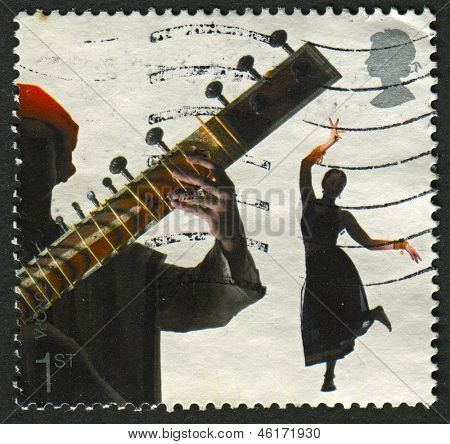 UK - CIRCA 2006: A stamp printed in UK shows image of the Bollywood and Bhangra, Sounds of Britain, circa 2006.