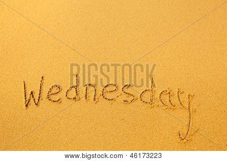Wednesday - written in sand texture.