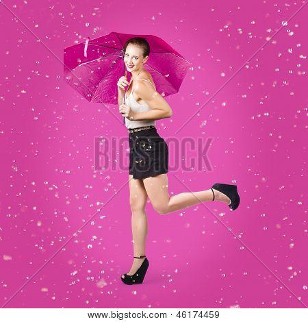 Smiling Female Model Dancing In Falling Rain