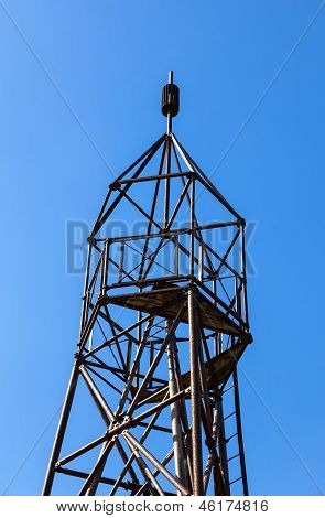 Geodetic Point Against Blue Sky Background In Sunny Summer Day