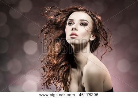 Fashion Girl With Flying Hair On Flare Background