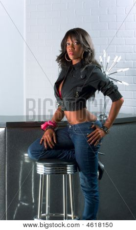 Urban African American Woman Standing By Counter