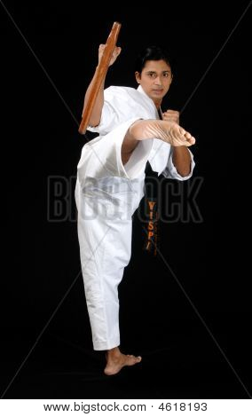 A Young Karate Teacher Demonstrating How To Side Kick For Self Defence.