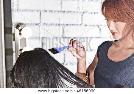 Hair Stylist coloring hair